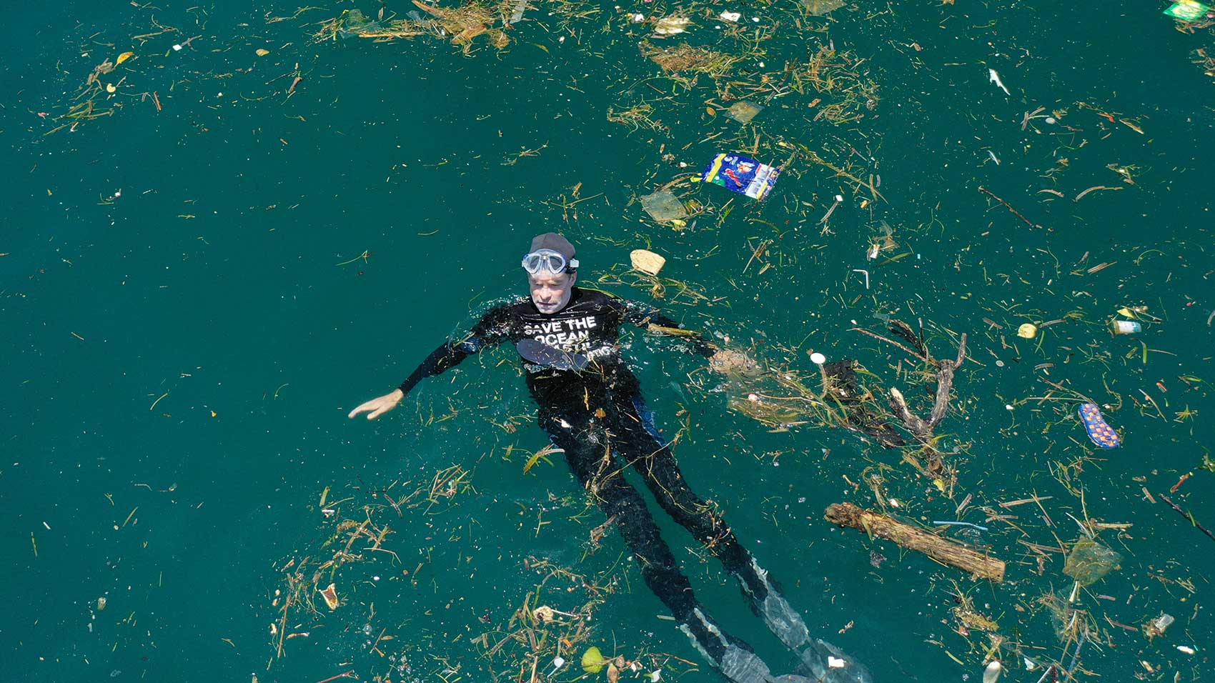 swimming in plastic ocean pollution