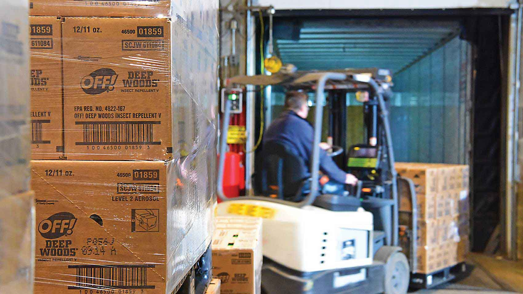 An employee moving pallets of donated products at SC Johnson