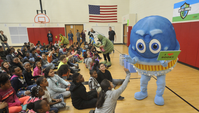 scruby the scrubbing bubbles mascot welcomes students at reading event