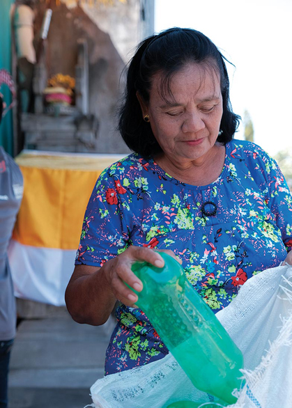 women recycling plastic bottle