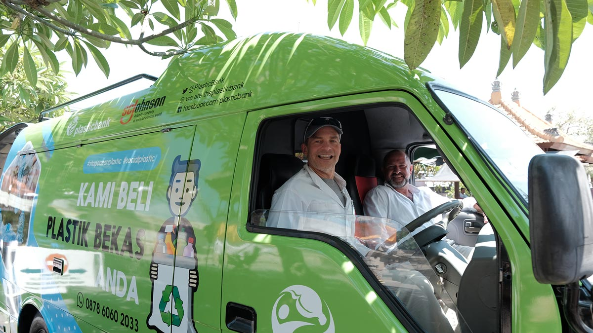 Fisk Johnson Chairman and CEO of SC Johnson and David Katz CEO of Plastic Bank unveil a mobile collection center in Indonesia