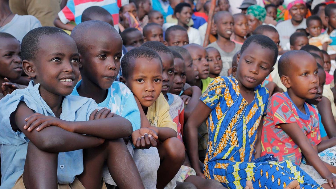 kids in rwanda watching presentation