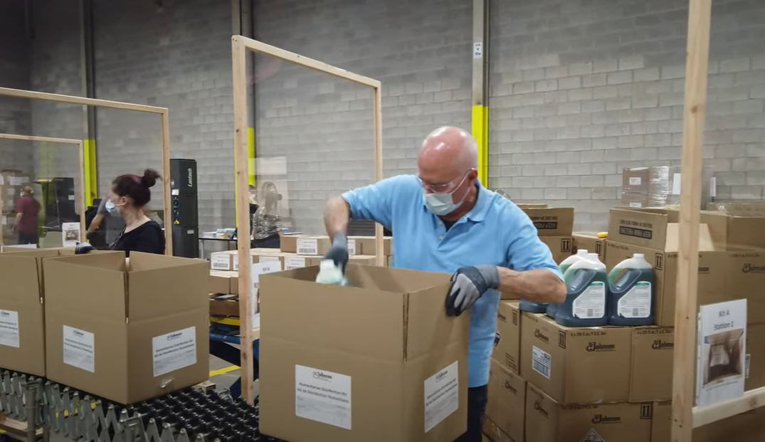 SC Johnson Employee Packing Up Disinfectant Kits to send to Nigeria.