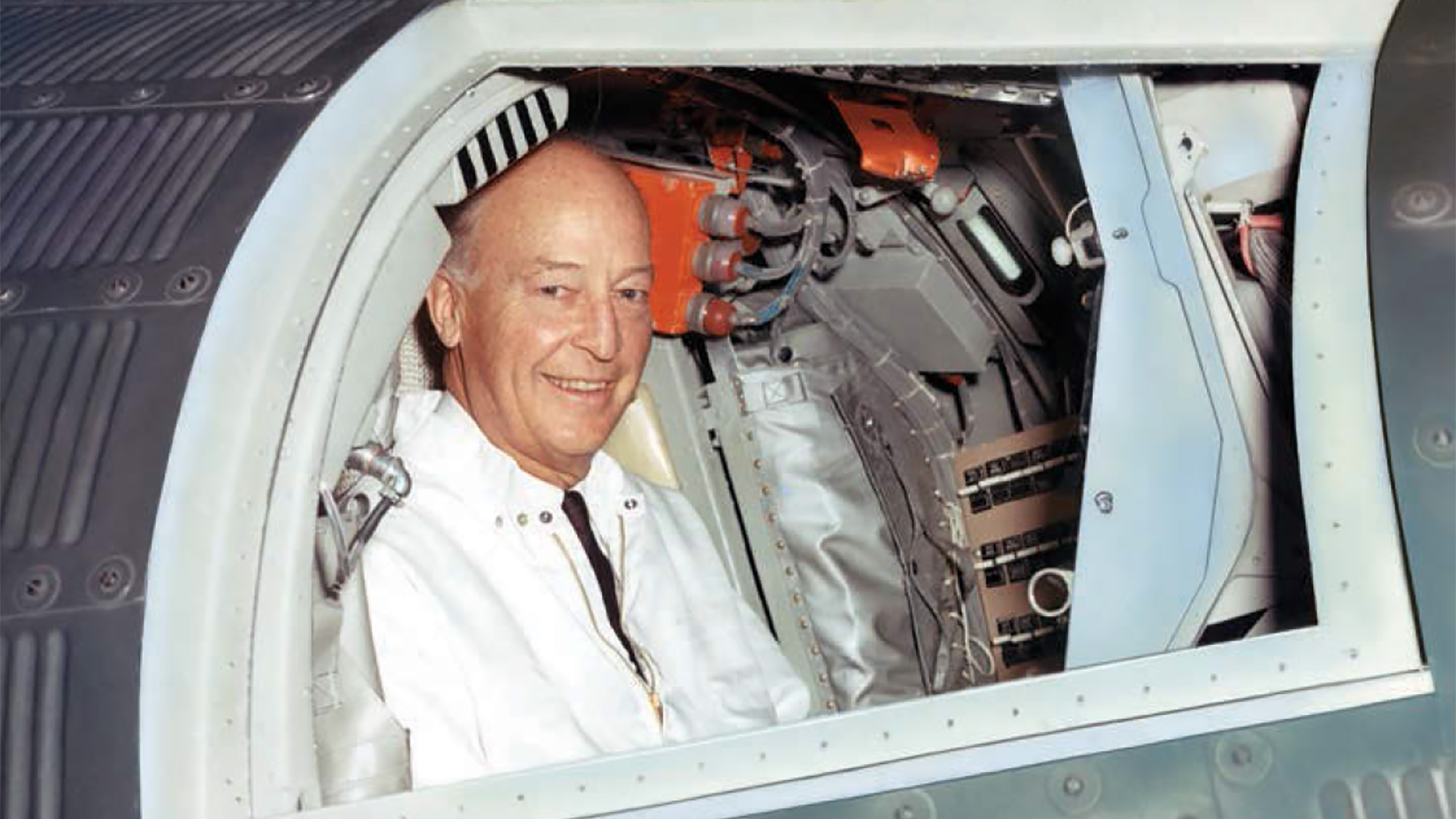 Herbert F Johnson, Jr. in a Mercury space capsule at McDonnell Aircraft