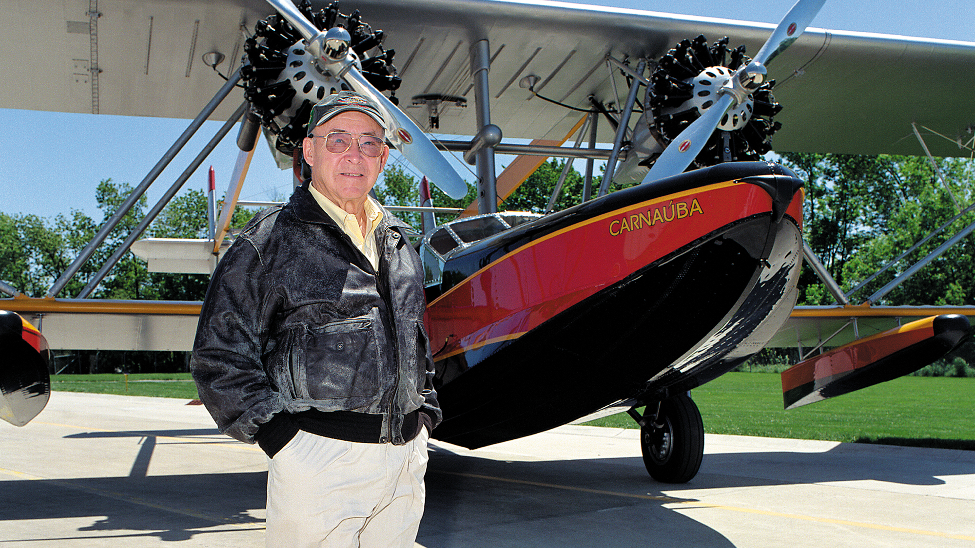 Sam Johnson with the Amphibian Plane