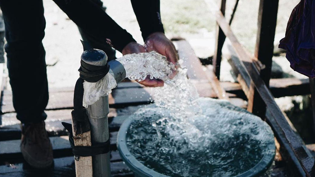 Person washing their hands at a clean water WASH station in Indonesia provided by Habitat for Humanity.